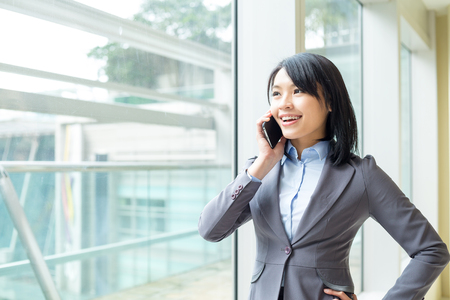 associate: Businesswoman talk to mobile phone