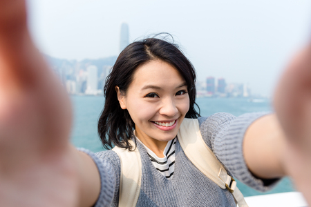 Woman take selfie image in Hong Kong