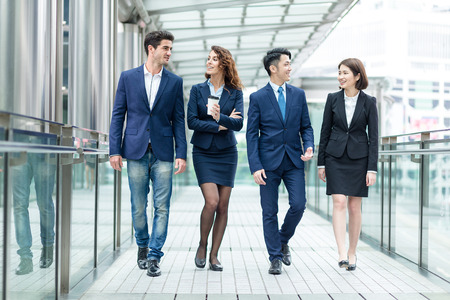 Group of business people talking to each other