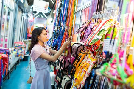 chose: Young woman shopping