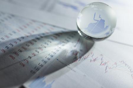 Glass globe with stock charts Stock Photo