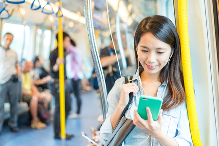Woman listen to song on phone