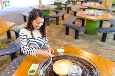 Woman enjoy japanese white noodles in restaurant