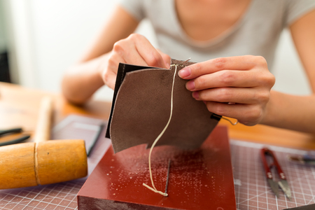 Woman making leather