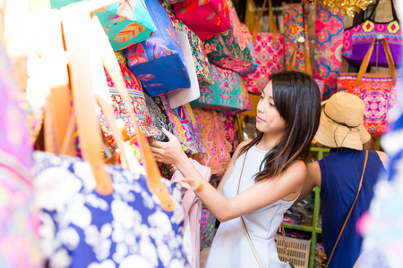 Asian Woman shopping in weekend market
