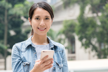 Woman use of mobile phone in Hong Kong