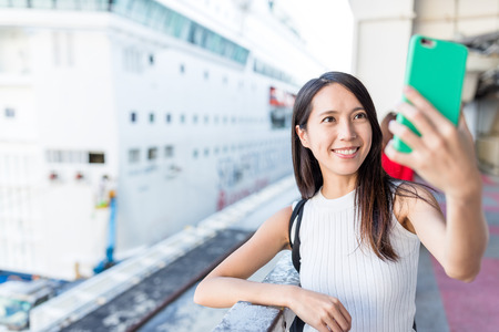Woman taking selfie with cruise