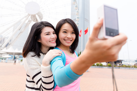 Two women taking photo together Stock Photo