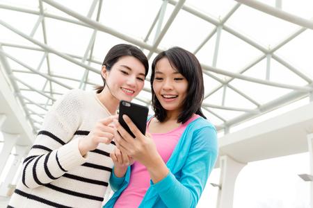 Women using cellphone at outdoor Reklamní fotografie - 82680211