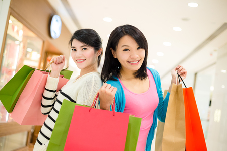 Woman carry lots of shopping bag in department store