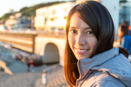 Woman in Kamakura seaside with sunset