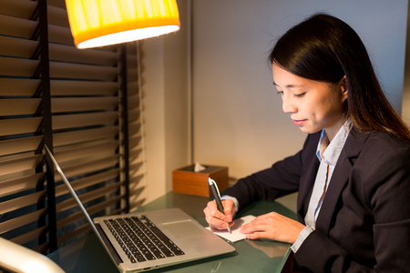 Business woman working on laptop computer