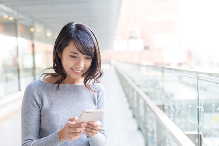 Woman use of cellphone Stock Photo