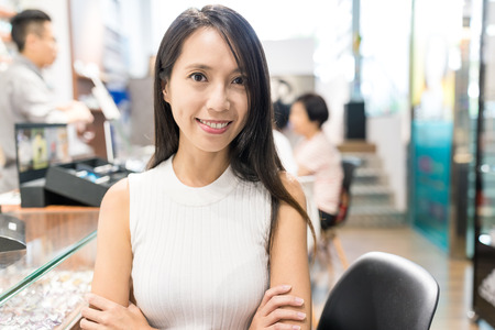 Woman holding small business in optician store photo