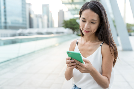 Woman checking on mobile phone Stock Photo