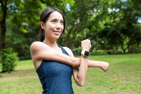 Sport woman sketching arm in the park Stock Photo