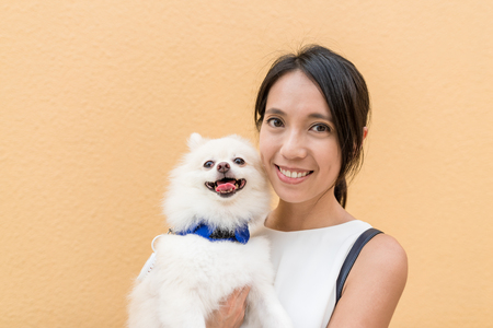 Woman with her dog Stock Photo - 88159320