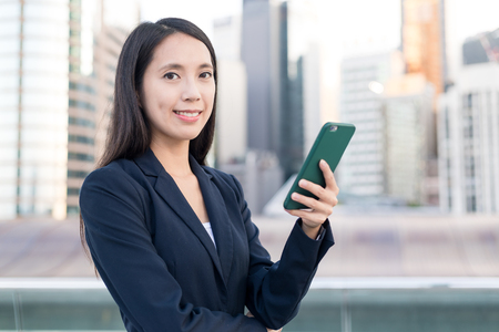 Business woman working on smart phone