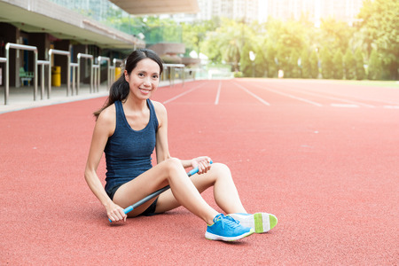 Sport woman using roller stick massage for her legs Stock Photo