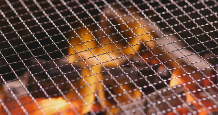 Charcoal fire with metal net Stock Photo