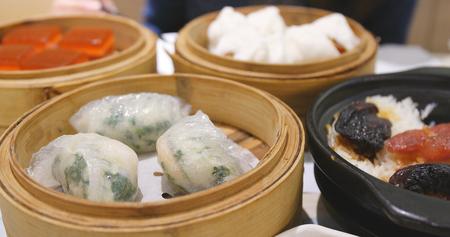 Eating chinese dim sum  Archivio Fotografico