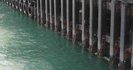 Wave crash on jetty wooden pier