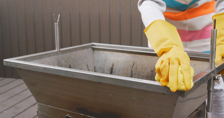 Cleaning of barbecue oven at outdoor  Banco de Imagens