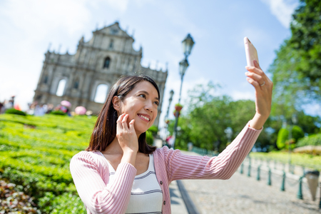 Woman taking selfie with mobile phone in St. Pauls Church Stock Photo