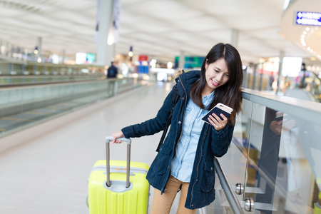 Woman travel with luggage in airport