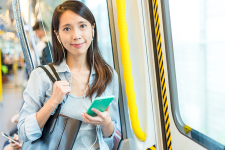 Woman listen to cellphone on train