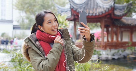 Woman making video call on smart phone in china