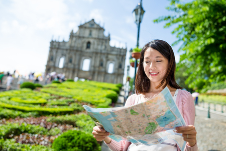 Yougn woman using city map in Macao