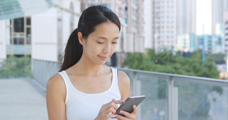Woman use of cellphone at outdoor  Stock Photo