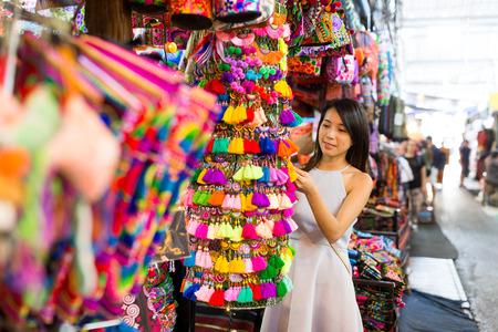 Woman enjoy shopping in weekend market 스톡 콘텐츠