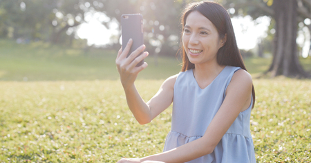 Woman making a video call at outdoor