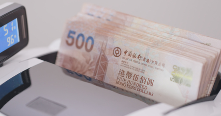 Banknotes in counting machine  Stockfoto