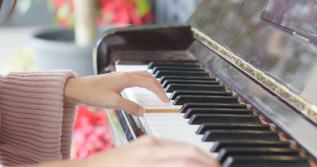Woman hand playing the piano