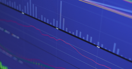 Stock market diagrams showing on screen