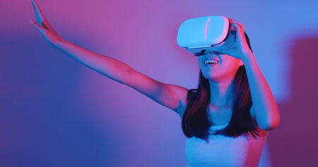 Woman play with VR device with red and blue light