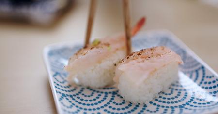 Having grilled shrimp sushi