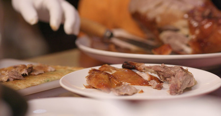 Chef cutting of grilled duck in restaurant