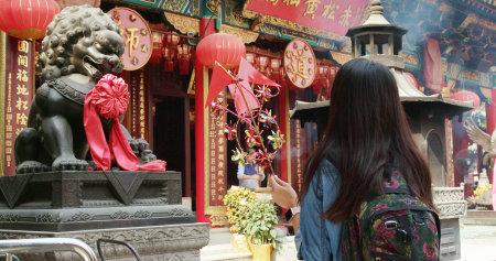 Wong Tai Sin, Hong Kong, 01 March 2018:- Woman visiting Wong Tai Sin temple Editorial