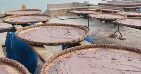 Shrimp paste being dried under the sun in Tai O