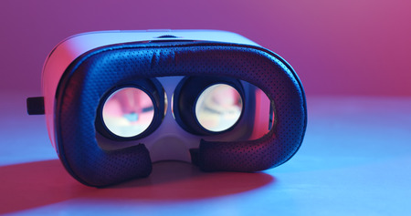 Holding virtual reality device with pink and blue light