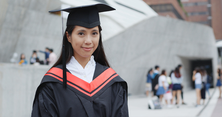 Asian Woman with graduation gown 스톡 콘텐츠