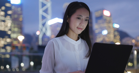 Woman use of notebook computer at night