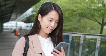 Young Woman use of smart phone in city