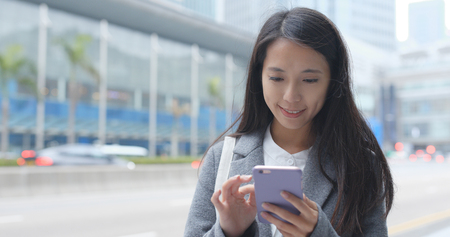 Businesswoman using mobile phone at outdoor