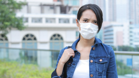 Woman wearing face mask 스톡 콘텐츠
