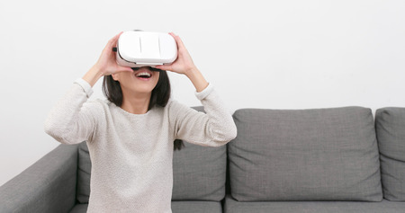 Woman watching with virtual reality device at home